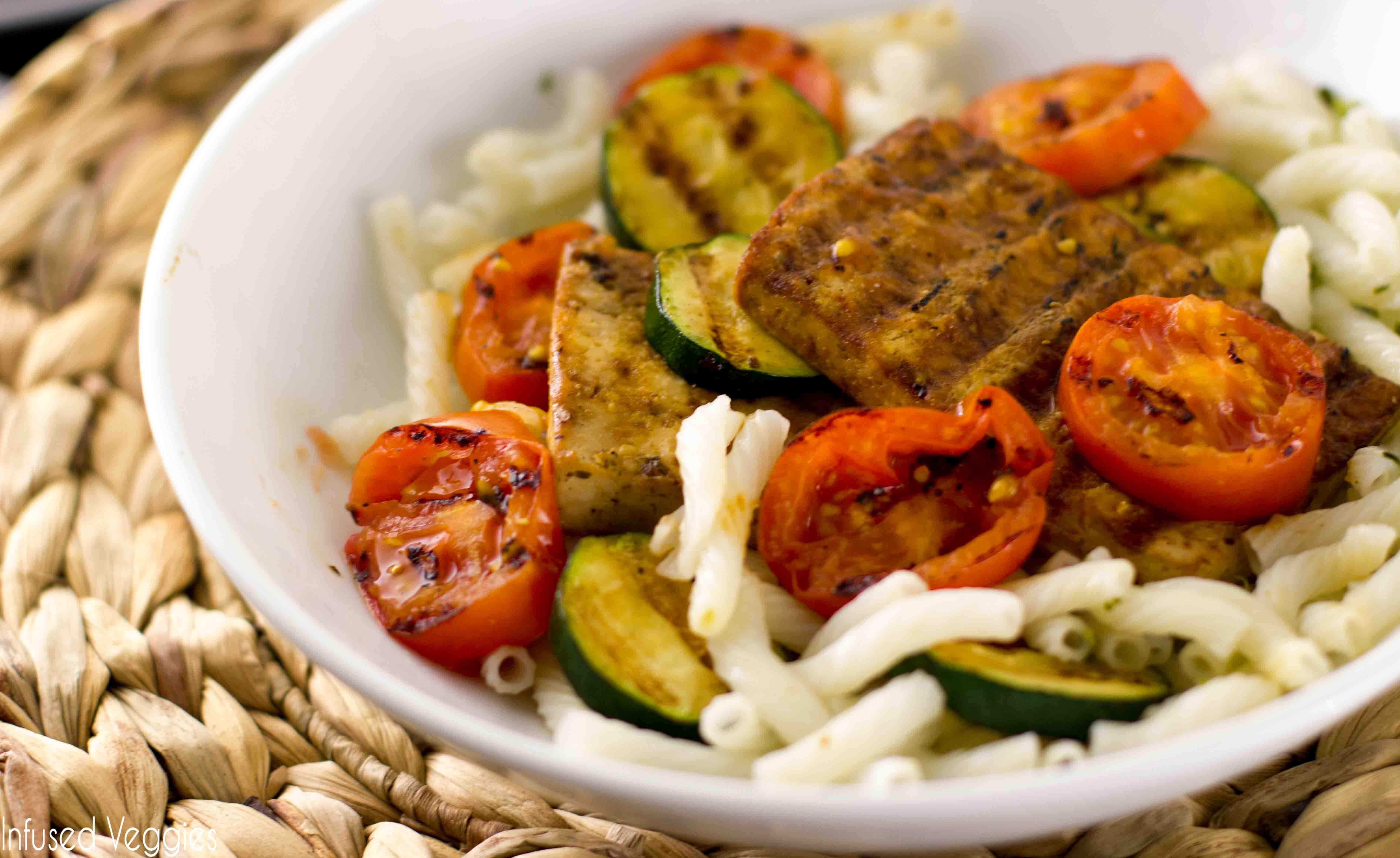 Grilled Tofu Steak - Roasted tomatoes, zucchini, and grilled tofu steak! Do I need to say more? Try this easy recipe today!  infusedveggies.com