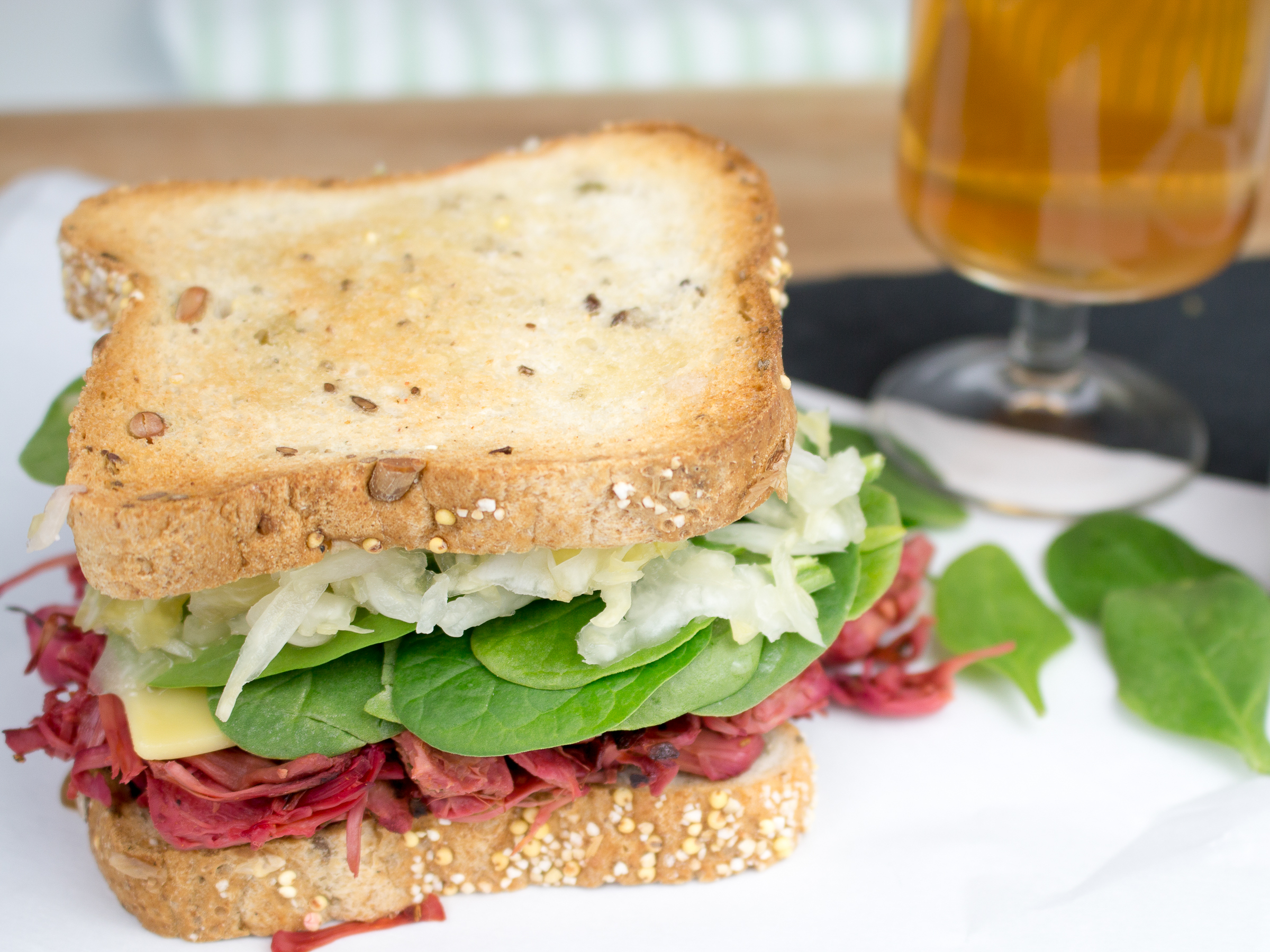 Whole Jackfruit Reuben sandwich with a beer