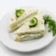 Cucumber sandwich with dill and cucumber slice on top