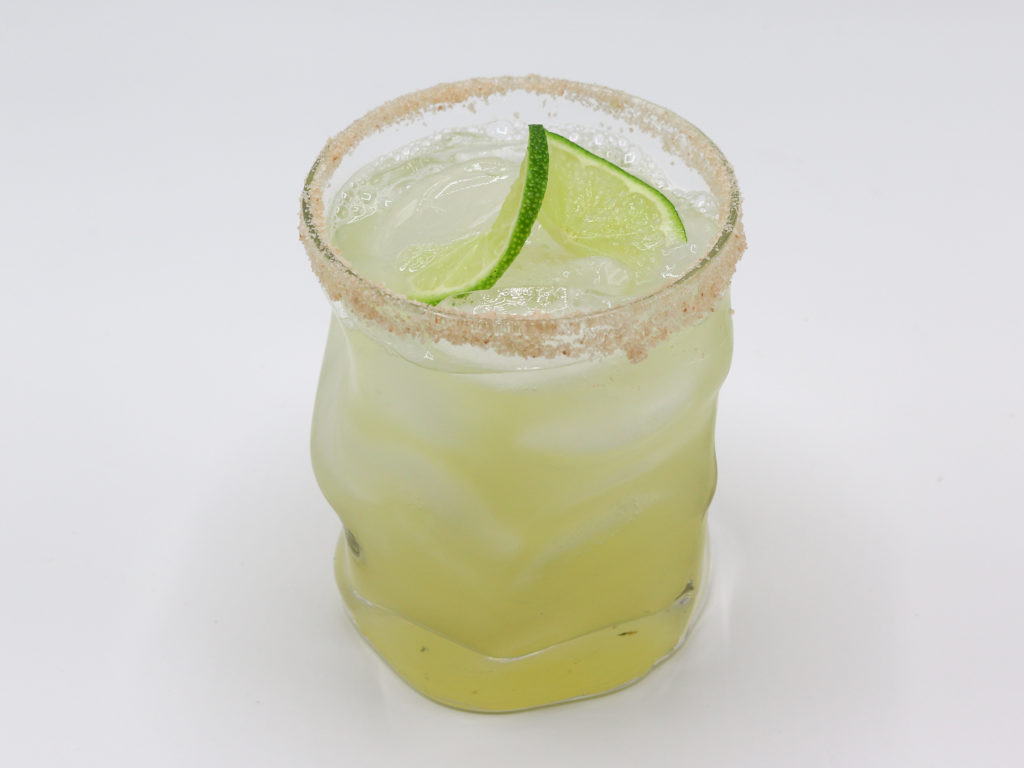 Side view classic margarita on white table top